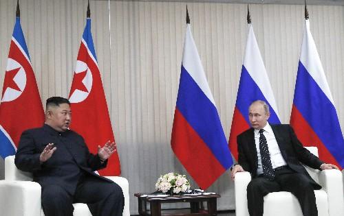 At Kim-Putin summit, hearty handshakes and manspreading