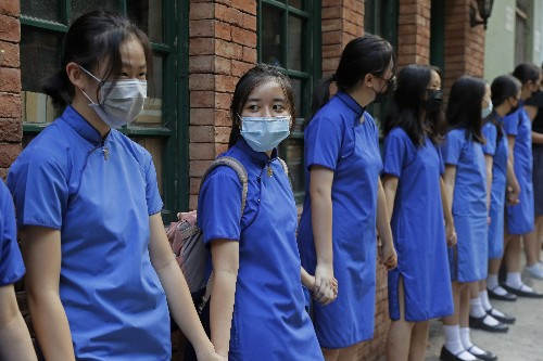 Hong Kong tells US to stay out; students form protest chains