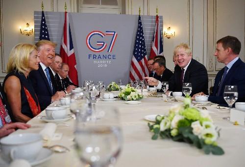 Trump caught off guard as Iran's Zarif visits G7 summit town