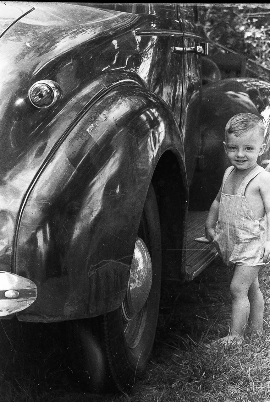 Me beside the 39 around 1945.