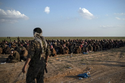 The Latest: Official: Kurds worked with US to find IS chief