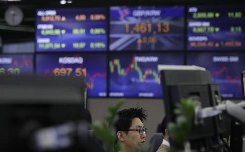 Asian shares buoyed by US earnings, upbeat talk on China