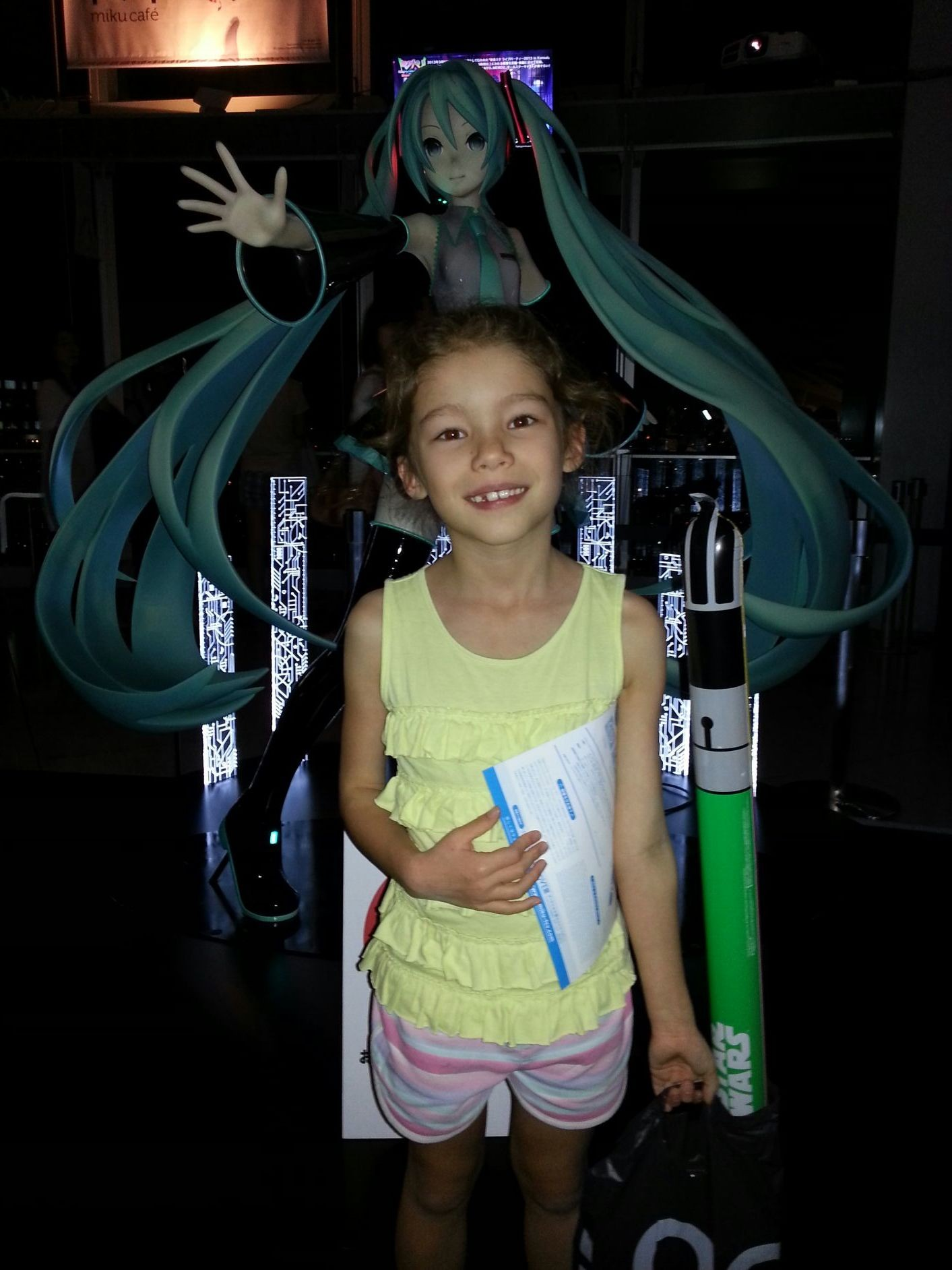 Standing in front of Miku, a famous person who doesn't exist.