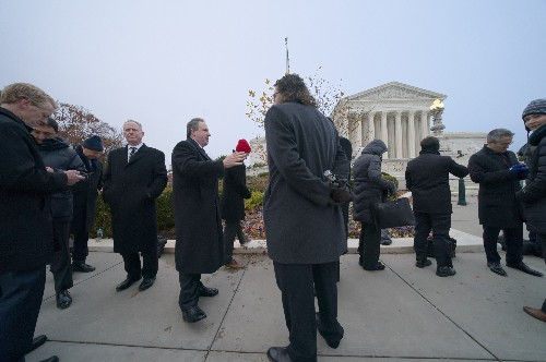 The Latest: Justices weighing dismissal of guns case