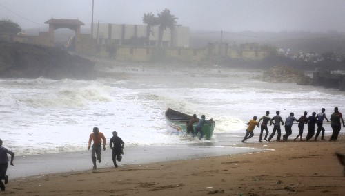 Cyclone batters fishing hub but veers away from Indian coast