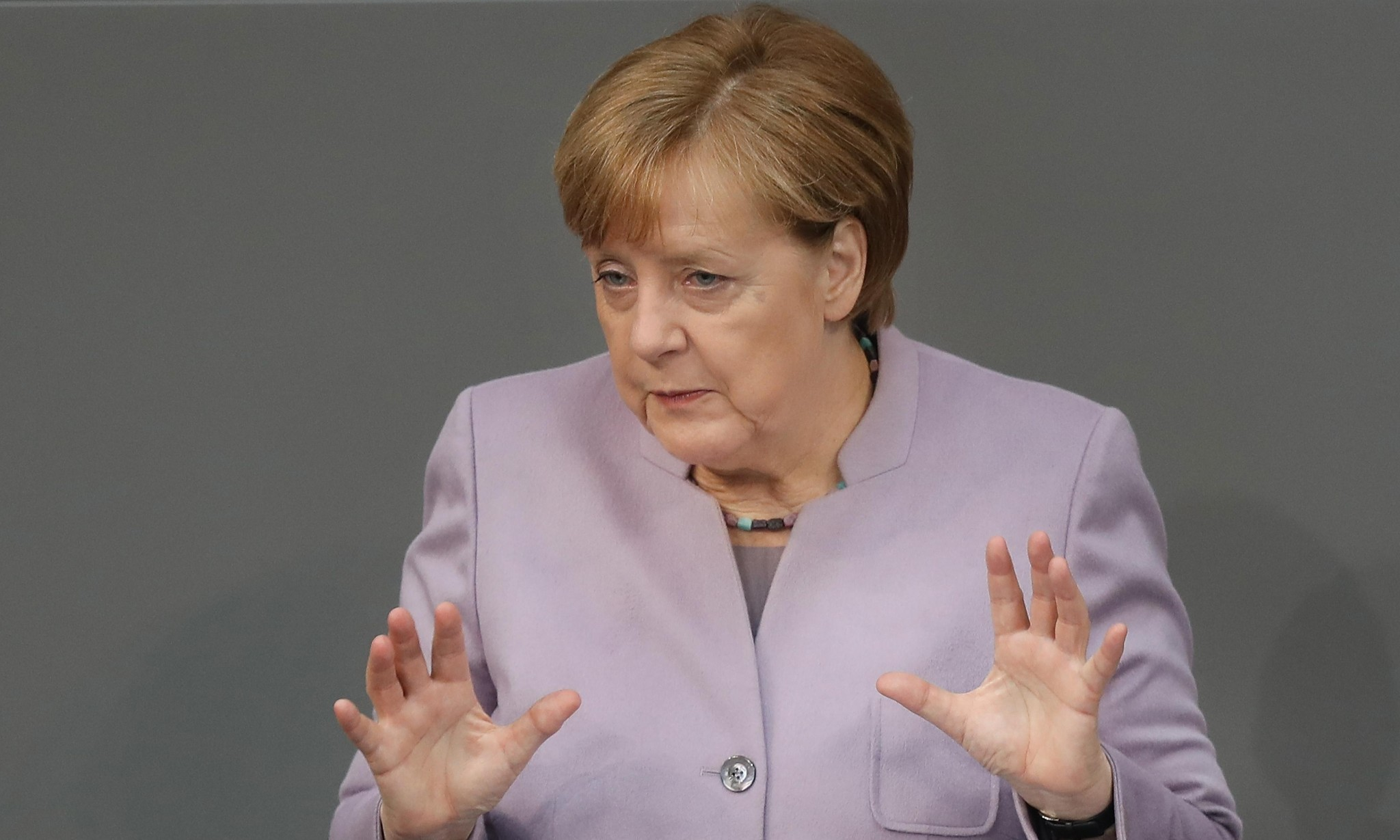 Angela Merkel attacks British 'illusion' of keeping benefits of EU