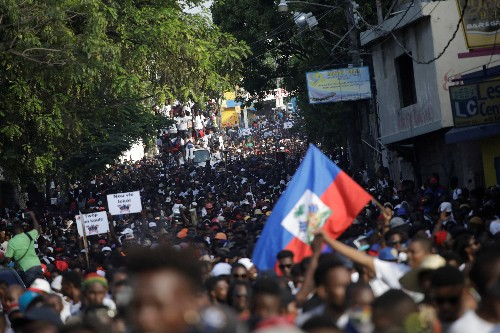 Singing and dancing, Haitians flock to streets in anti-government protest
