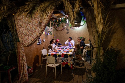 Israelis take to frond-covered huts as Jewish high holy days wind down
