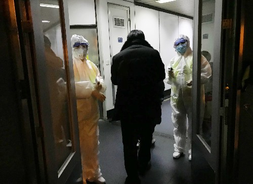 Years after SARS, a more confident China faces a new virus