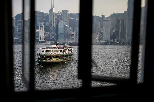 Battered Hong Kong faces economic recession, existential crisis