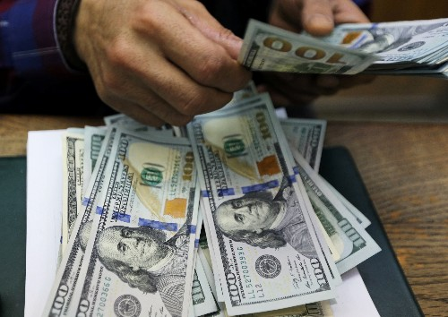 Dollar steadies after upbeat U.S. data amid holiday-thin trade