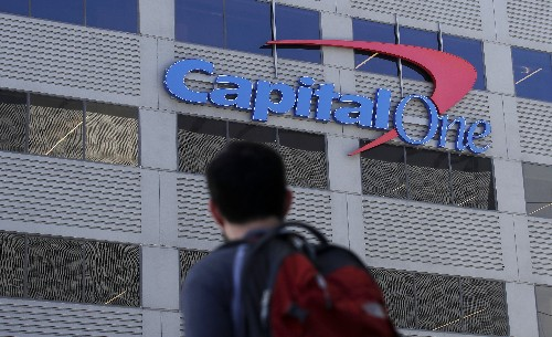 The Latest: Woman in Capital One case to stay in custody