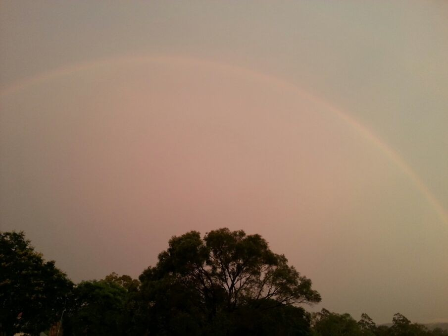 This rainbow might be the most perfect I've ever seen - the storm before it was huge!