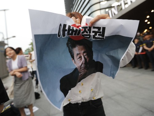 The Latest: S. Korean man dies of burns near Japan Embassy