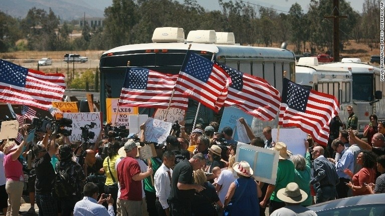 Protesters block buses carrying immigrants