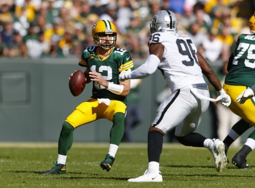 NFL roundup: Packers rout Raiders behind Rodgers' 6 TDs