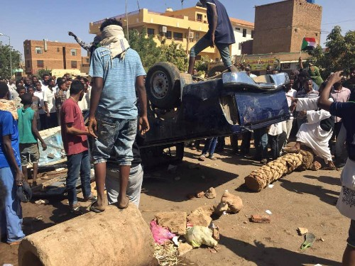 Sudan police shoot live fire outside home of dead protester: witness