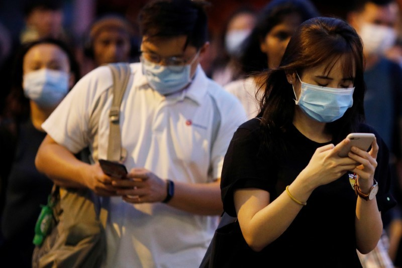 Steamy Singapore says face shields no substitute for mandatory masks