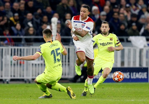 Soccer: Lyon shares fall after club's goalless draw against Barcelona