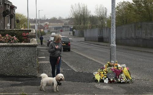 Northern Ireland police free 2 men held in reporter's death