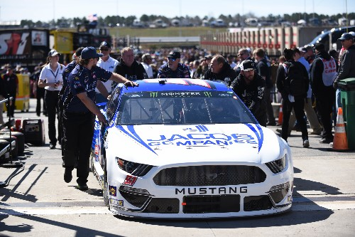 Keselowski fights illness, earns 2nd career Atlanta win