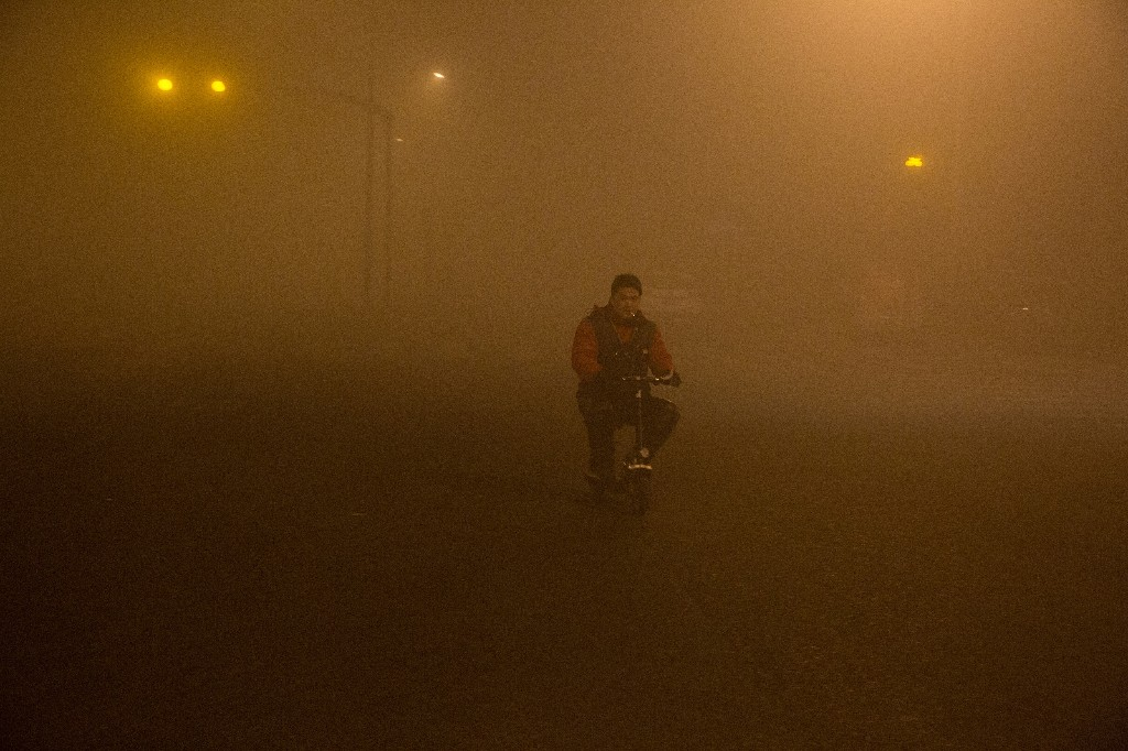 Chinese official hails 'incomparable' improvement in air quality as virus hits industry