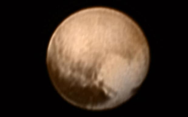 Giant heart spotted on Pluto in closest ever pictures of dwarf planet