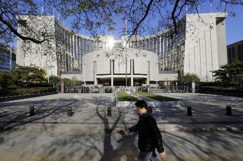 China's central bank says to keep yuan stable, in balanced range