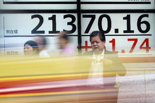 Asian shares mixed as investors look ahead to rate decisions