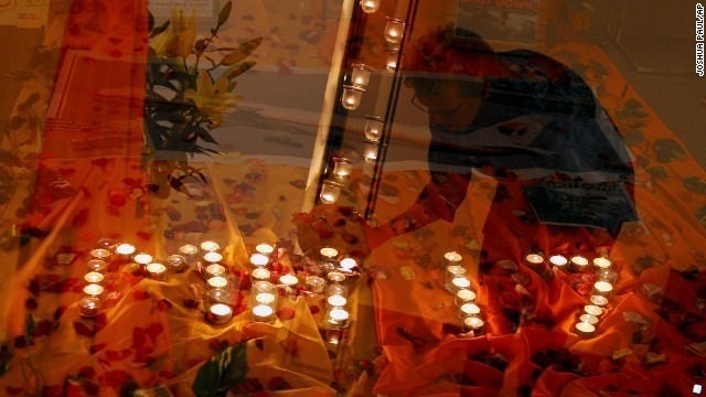 Friends, relatives grieve for MH17 passengers