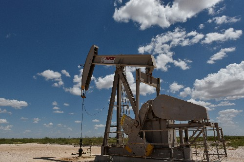 Exclusive: IEA revising oil demand growth forecast down on slowing economy