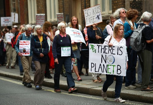 Protesters gather at Britain's parliament to urge climate action