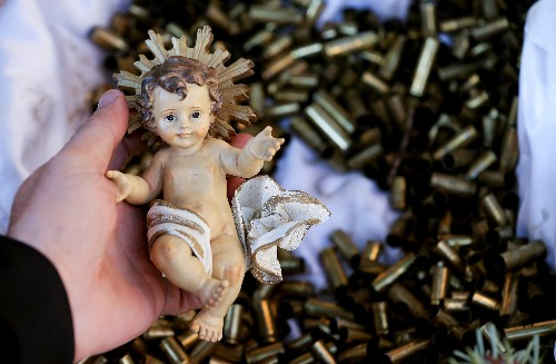 Franciscan monks put baby Jesus on bed of bullets to press for peace
