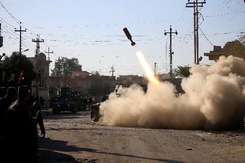 Iraqi forces reach a second Mosul bridge, fight near university, military says