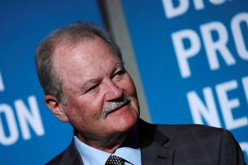 AIG shareholders approve $21 million pay package for CEO