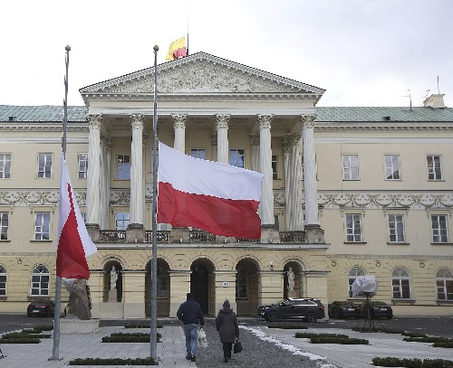 Poles place candles and flags at half-staff for slain mayor