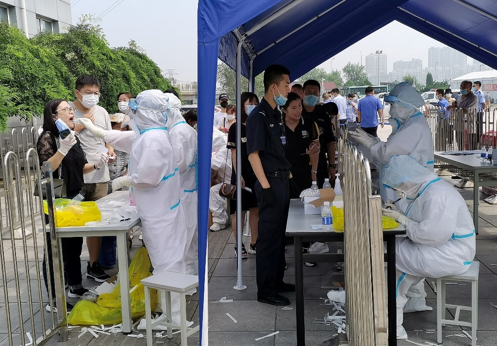 China reports 61 new COVID-19 cases for Sunday, highest daily domestic infections since March 6