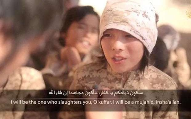 Isil jihadists show off their child 'executioner'