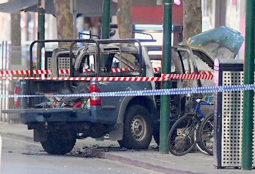Gas-laden truck set afire, three stabbed, one dead in Australia terror attack
