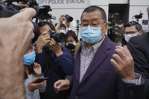 Outspoken Hong Kong publisher held over pro-democracy march