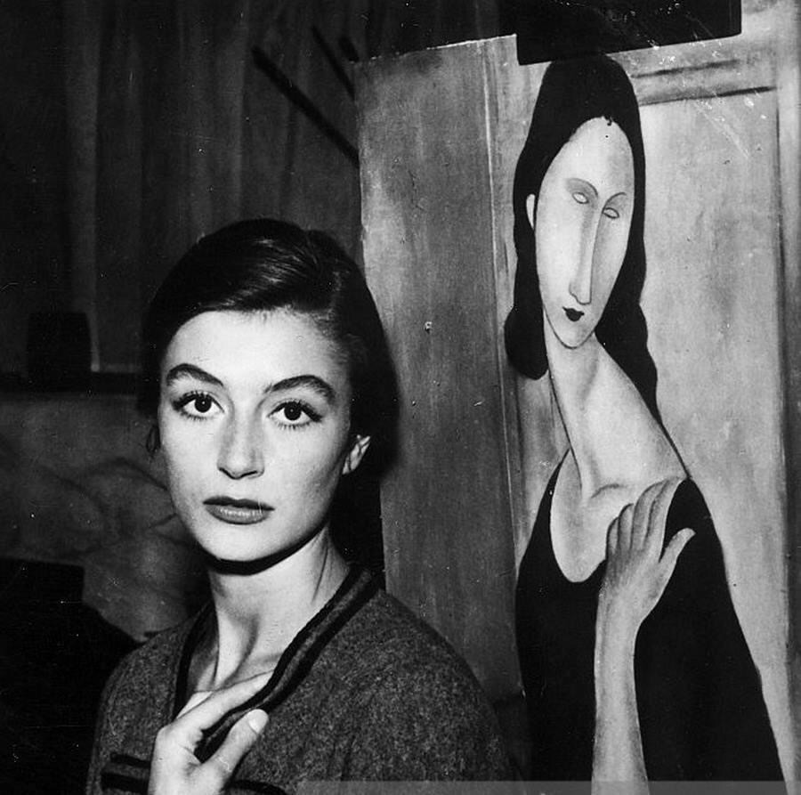 Anouk Aimée with a Modigliani painting, 1957.