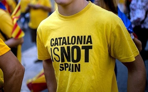 Catalans call for 'yes' vote in Scotland as they march for independence from Spain