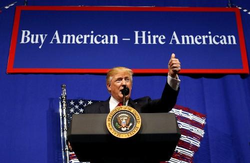 Trump orders review of visa program to encourage hiring Americans