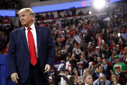 Trump mocks impeachment effort, talks up trade deal at rally