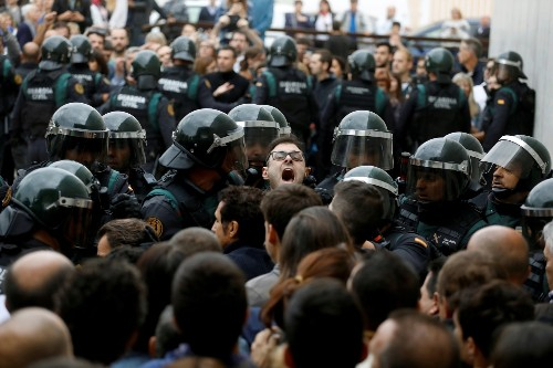 Protesters, Police Clash During Vote in Spain: Pictures