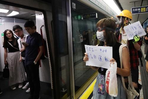 Hong Kong protesters gather at mob-attack subway as bank warns of economic fallout