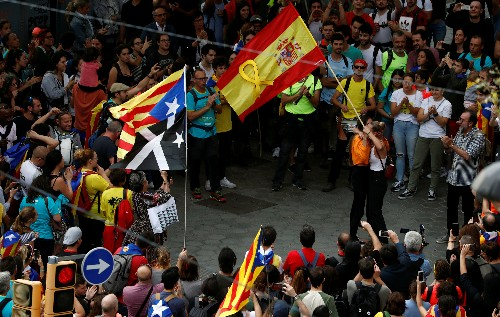 Spain closes Catalan protest group website and probes riots