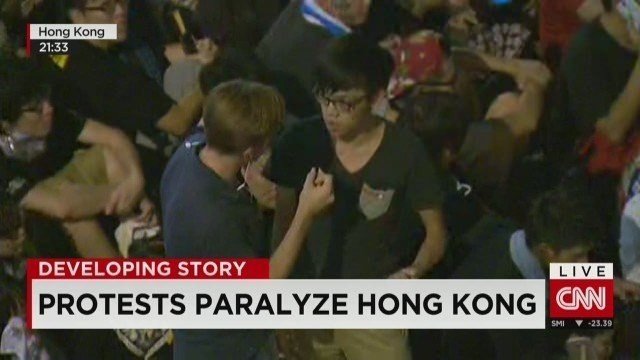 After clashes, Hong Kong protesters dig in