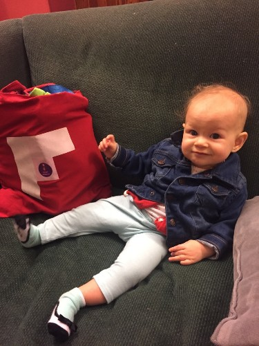Violet sports the Flipboard tote bag, perfect for carrying all of your supplies to and from school