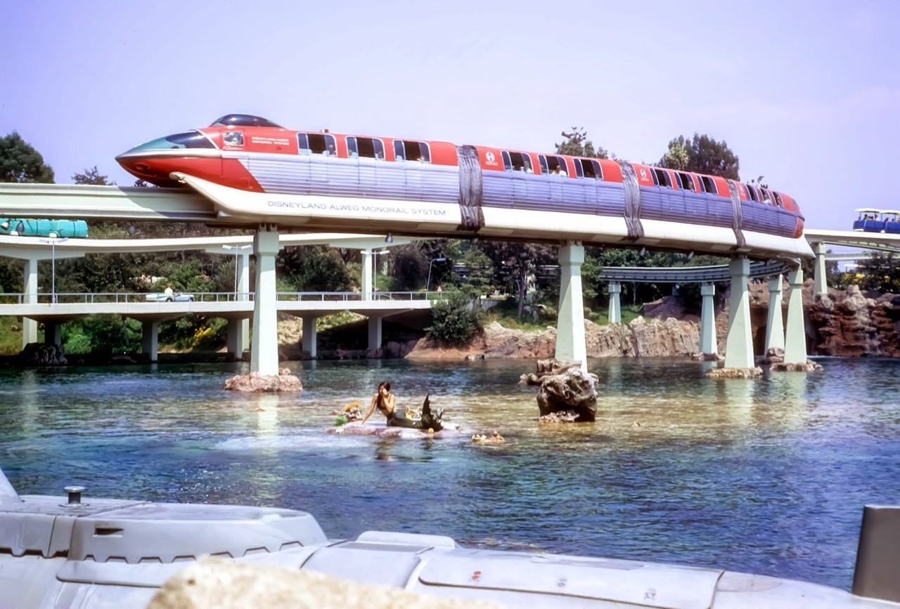 Daily Vintage Disneyland: Disneyland's Tomorrowland from 1967 with the Monorail, Peoplemover, Submarine & a few Mermaids swimming around #disney #disneyland #tomorrowland #monorail #peoplemover #submarine #mermaids